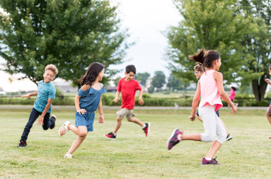 kids running in grass field